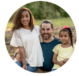 Picture of a dad with two daughters