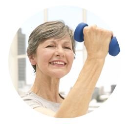 Picture of older woman working out and smiling.