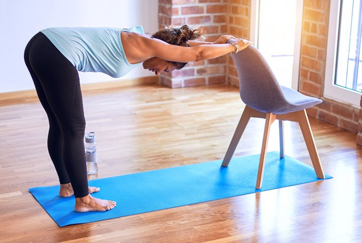 Chair yoga can be an excellent way to loosen and stretch muscles safely.